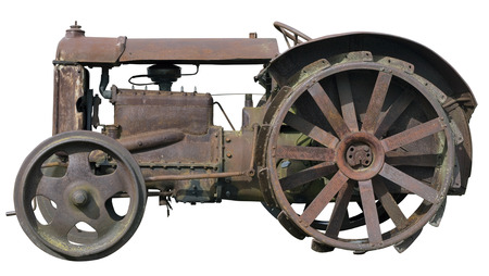 no name: Rusty  vintage  small rural  no name tractor. The metal equipment is made more than hundred years ago. Mass production. Isolated
