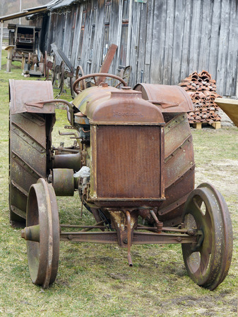 agrarian: VILNIUS, LITHUANIA -APRIL 03, 2016: Retro rusty agrarian American tractor Fordson brand in the museum of agriculture. The museum is located in the historical Vilnius area - Pilaite Editorial