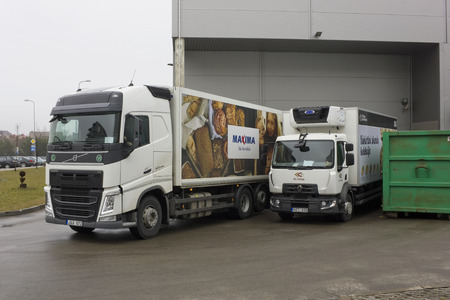 retailing: VILNIUS, LITHUANIA - MARCH 12, 2016:  Unloading of products from a Maxima cargo vans with advertizing of fresh bread. In the Baltic States and other countries opened more than 500 Maxima stores