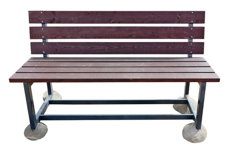 vandal: Wooden beach bench with a metal anti vandal framework. Not to plunge into sand, each leg of a bench is on a concrete pad. Isolated on white Stock Photo
