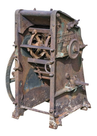 agricultural engineering: Retro  vintage rusty agricultural machinery - mechanism for processing and crushing of straw. Equipment is made more than hundred years ago.  Isolated on white