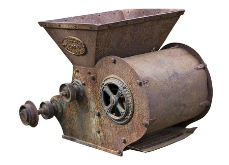 agricultural engineering: Retro   agricultural machinery - mechanism for  crushing of straw. Equipment is made more than hundred years ago.  Isolated on white. Art soft focus Stock Photo