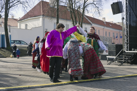 winter dance: VILNIUS, LITHUANIA - MARCH 13, 2016: The  fair devoted to spring and a farewell to winter. People dance on solar streets and eat pancakes. Ahead the Lent before Easter Editorial