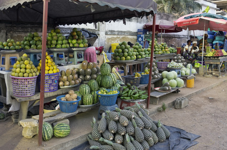 fruit trade: ACCARA, GHANA - JANUARY 22, 2016: Retail trade in fruit and vegetables on one of streets of the capital of Ghana. As sellers only women work generally