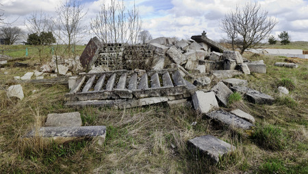 no name: Concrete blocks and ladders - ruins of the old destroyed no name rural house. Panoramic collage from several photos