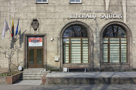 easter morning: VILNIUS, LITHUANIA - MARCH 27, 2016: Office of the Lithuanian Liberal party (Liberalu Sajudis) it is located in the old house of Stalin times.  Party members  have a rest. Solar quiet Easter morning
