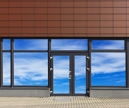 no name: Glass door and windows with sky reflections of new no name office in the modern mass production  building. Collage from several photos.  Glass isolates with patch