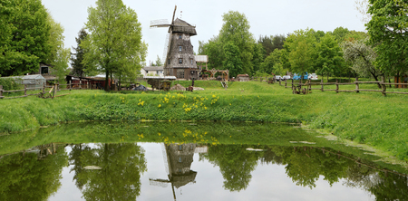 an agricultural district: VILNIUS, LITHUANIA - MAY 15, 2016: Ethnographic museum of a retro agricultural equipment , tools and buildings in the territory of an old windmill. It is Pilaitie area- the most forest and lake district of the Lithuanian city. Editorial