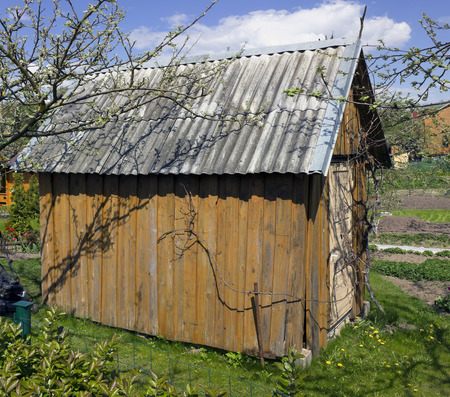 agricultural tools: No name self made shed for storage of agricultural tools in a spring solar garden