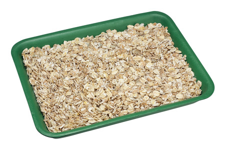 processed grains: Dry mix for quick-cooking cereal from previously processed grains of cereals - wheat, oats, millet, rye and so on. Green plactic container. Isolated with patch