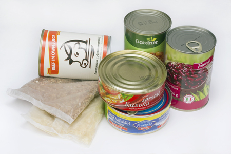 VILNIUS, LITHUANIA - MAY 13, 2016: Grocery set of canned food of the poor tourist and fan's gardener - a sprat in a tomato, fish meatballs, haricot and beans, stewed meat, buckwheat and rice. It is made in Baltic and Russia