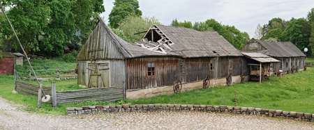 an agricultural district: VILNIUS, LITHUANIA - MAY 15, 2016: National  museum of a retro  agricultural equipment , tools and buildings in the territory of an old windmill. Pilaitie area- the most forest and green district of the Vilnius.
