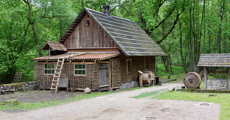 an agricultural district: VILNIUS, LITHUANIA - MAY 15, 2016: Ethnographic museum of a retro  agricultural equipment , tools and buildings in the territory of an old windmill. It is Pilaitie area- the most forest and green district of the Lithuanian city.