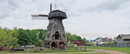 an agricultural district: VILNIUS, LITHUANIA - MAY 15, 2016: New museum of a retro agricultural equipment , tools and buildings in the territory of an old windmill. It is Pilaitie area- the most forest and rural district of the Vilnius.