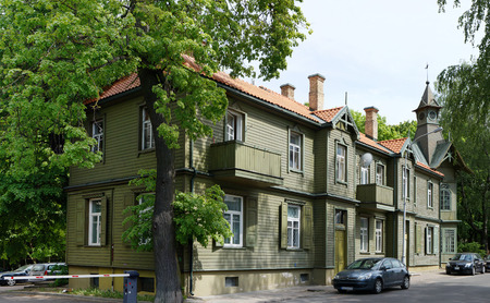 ingenious: VILNIUS, LITHUANIA - MAY 20, 2016: The wooden historical house number 33 on the street of a name of the ingenious Lithuanian artist and composer - Chiurlionis, has been built at the end of the 19th century. Editorial