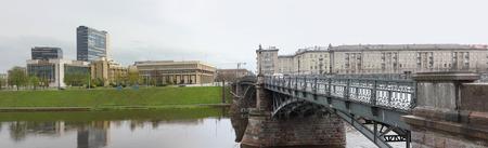 buisiness: Lithuanian national parliament  (Seimas)  is located on the river Neris bank near Zverinas (Zoo) bridge. Rainy day urban landscape Stock Photo
