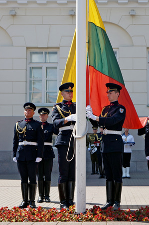 raise the white flag: VILNIUS, LITHUANIA - MAY 29, 2016: Soldiers of national armed forces  of the Republic of Lithuania prepare for solemn raising of national flags near the presidential palace Editorial