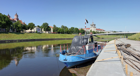 VILNIUS, LITHUANIA - MAY 29, 2016: Repair of city granite Nerys River Embankment. After renovation of the coast will become the main recreation area of citizens. 10 million euros are allocated for repair from the budget. Editorial