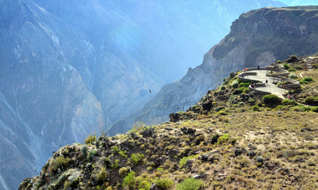 eagle canyon: COLCA, PERU- JUNE 09, 2016:  Colca Canyon in southern Peru. With a depth of 3,270 m. it is one of the deepest in the world. From an observation square Cruz del Condor tourists observe flights of eagles Editorial