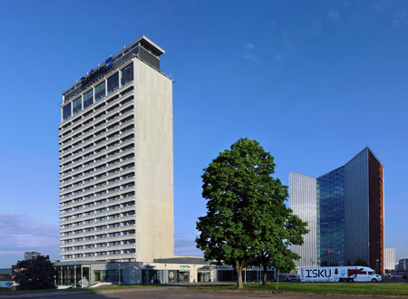 VILNIUS, LITHUANIA - MAY 25, 2016: Radisson Blu Hotel  and Swedbank in spring morning lights. Radisson is an international hotel company with more than 990 locations in 73 countries. The first Radisson Hotel was built in 1909