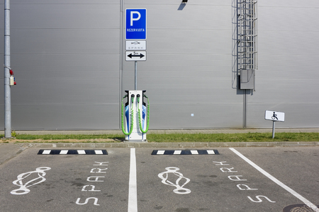 electric spark: VILNIUS, LITHUANIA - JUNE 26, 2016:  Redundant places for rent and charging of electric cars of the modern global European Spark system near the supermarket Maxima. It is  Pilaite area of Lithuanian capital