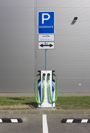 electric spark: VILNIUS, LITHUANIA - JUNE 26, 2016:  Redundant places for rent and charging of electric cars of the modern European Spark system near the supermarket Maxima. It is  Pilaite area of Lithuanian capital Editorial
