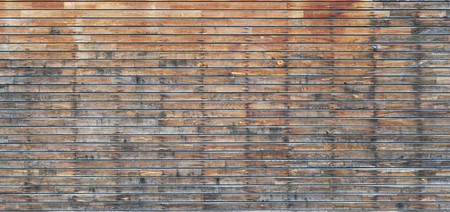 surface aged: Fragment of a surface of a long wooden old home wall from short aged pine horizontal boards, which are fastened by screws Stock Photo
