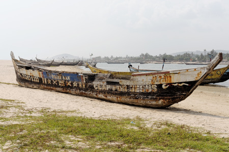 colonization: ACCARA, GHANA - FEBRUARY 22, 2014: Fishing poor boats on sea sand coast in rural fishing village.  In 1957, Ghana became the first African nation to declare independence from European colonization. Editorial