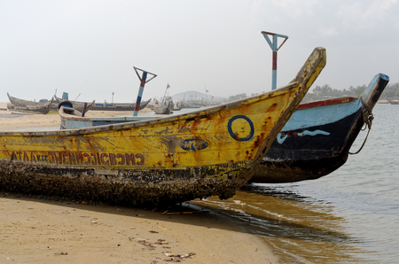 colonization: ACCARA, GHANA - FEBRUARY 22, 2014: Fishing poor boats on sea sand coast in rural fishing village.  In 1957, Ghana became the first African nation to declare independence from European colonization. Stock Photo