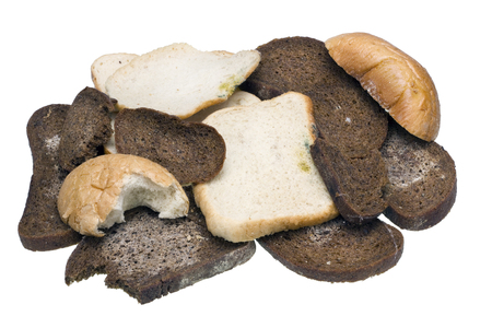 stale: Stale dry mouldy rotten bread isolated Stock Photo