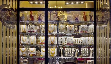 explored: VILNIUS, LITHUANIA - DECEMBER 26, 2014: Night show-window of shop of the Lithuanian amber and jewelry. Explored reserves of amber in Lithuania make about 500 tons. A production quota - 30 tons per year.
