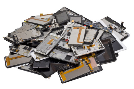 Big heap of the  broken and cracked  cellular telephons and  tablets. Mass production devices are prepared for industrial utilization. Isolated with patch studio shot