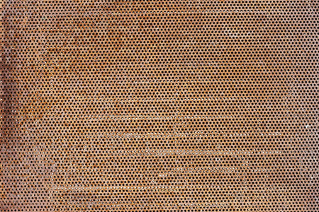 than: More than six thousand round holes in a rusty steel sheet background Stock Photo