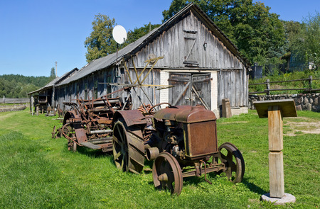 VILNIUS, LITHUANIA - august 26, 2016: Rural museum of a retro agricultural equipment , tools and mashinery in the territory of an old windmill. It is Pilaitie area- the most forest and lake district of the Lithuanian city.