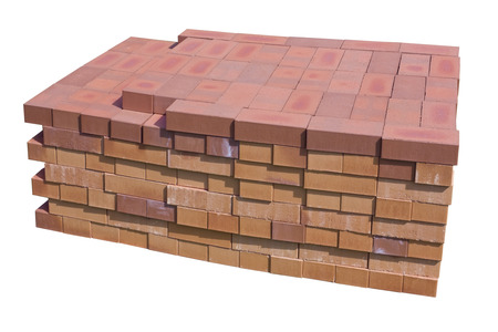 resistant: Stack of fire modern fire resistant  special red clay bricks for construction of fireplaces and furnaces in rural homes. Isolated with patch Stock Photo
