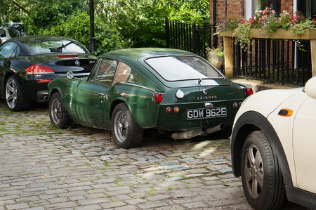 rusts: BLACK POOL, ENGLAND - AUGUST 28, 2016: Rare green sports retro vintage car Triumph GT6 rusts on the street. It is a 6-cylinder coupe production ran from 1963 to 1972