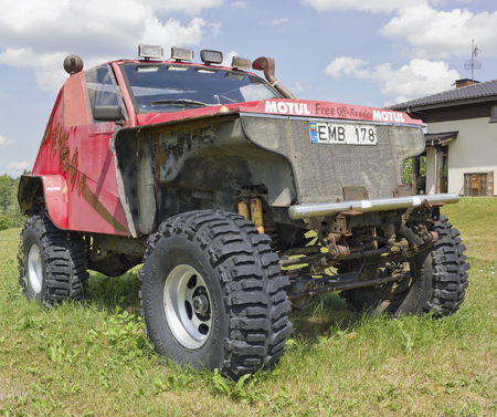 advertizing: VILNIUS, LITHUANIA - JULY O2, 2016:  Lavender Village in Kiemeliu rural area. Advertizing slogan of Motul brand on handmade broken all-terrain vehicle. Founded in 1853 in New York company manufactured  lubricants Editorial