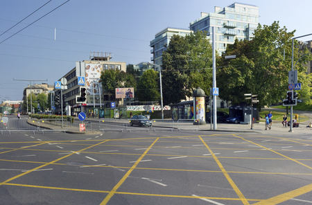 forbids: VILNIUS,  LITHUANIA - SEPTEMBER 11, 2016: The new yellow intersection marking of intersections forbids a stop of transport and blocking of the movement. It allows to move more safely. It is a Kalvariu and Zuviu  streets
