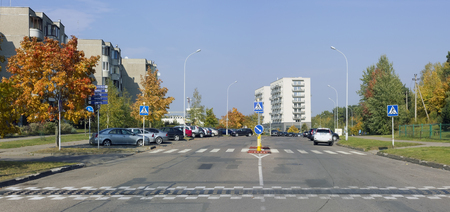 VILNIUS,  LITHUANIA - OCTOBER 02, 2016: Deserted autumn Sunday Smalines (Pitch) Street  in the residential dormitory area of the Lithuanian capital - Pilaite. Sunny day urban landscape
