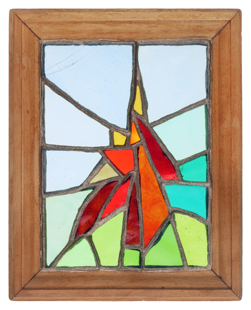 simple abstract handmade stained glass window in a wooden frame