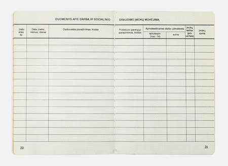 place of employment: VILNIUS, LITHUANIA - JANUARY 05, 2017: Empty pages of  Lithuanian worker book from 1990. Texts on Lithuanian - payments of social insurance, place of employment, profession, salary, rate, amount and so on.