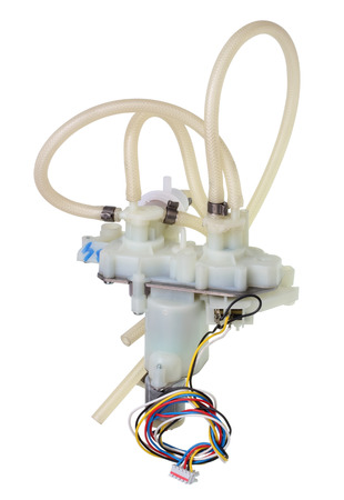 The broken artificial heart of the mechanism concept. Valves and silicone hoses as blood vessels.Isolated