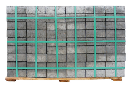 accurately: On the wooden pallet the new concrete gray paving slabs are accurately put. Isolated on white