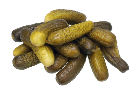 marinated gherkins: A lot of marinated cucumbers pickles on a holiday table. Isolated Stock Photo