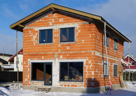 no name: Construction of the mass production no name red brick house, incomplete because of winter cold and snow
