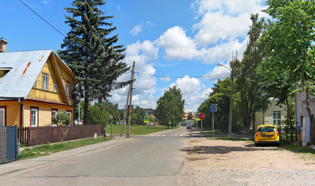 VILNIUS, LITHUANIA - JULY  06, 2017:  Fragment of the street, green lawns and rustic style  apartment buildings in the historic elite central area of the Lithuanian capital - Zverinas (Zoo park) Editorial