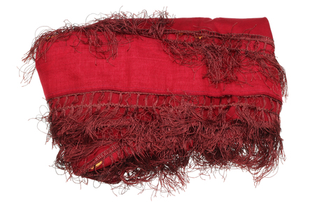 A large dark maroon female scarf with a fringe of their threads is piled up. Isolated on white Stock Photo