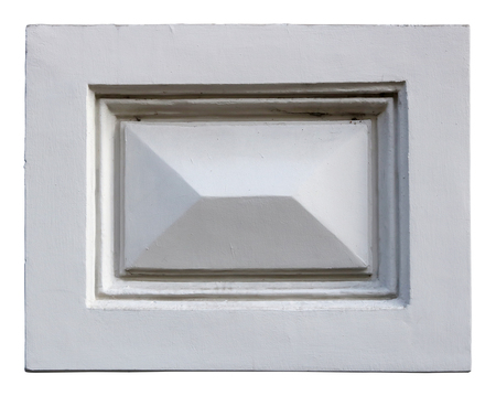 A standard old home molding in the form of a rectangle is made of white plaster. Isolated with patch outdoor shot