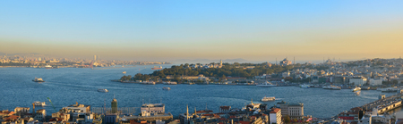 Evening sunset over the roofs and sea  of the Turkish capital - Istanbul. Panoramic collage from several photos. All logos remoced. Standard-Bild