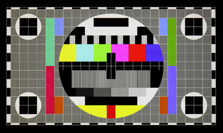 Photo shot of standard industrial color television test pattern on the no name modern smart phone real screen with resolution 1280 by 720 pixels. A well visible point like LED texture
